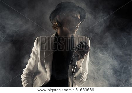 jazz singer woman with retro microphone in smoke