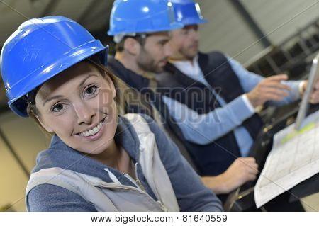 Cheerful woman industrial engineer at work