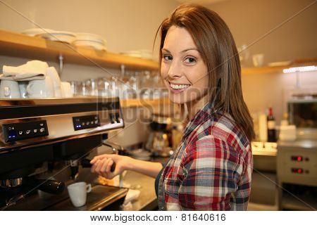 Coffeeshop keeper preparing expresso
