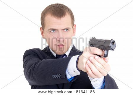 Serious Man In Business Suit Shooting With Gun Isolated On White