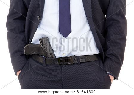 Detective, Policeman Or Bodyguard With Gun In Pants Isolated On White