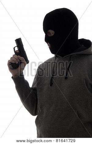 Dark Silhouette Of Criminal Man In Mask Holding Gun Isolated On White
