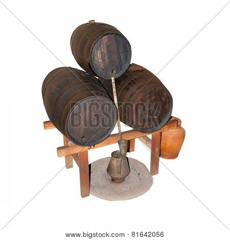 Three wine barrels with wine making equipment