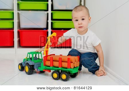 child plays with a timber truck