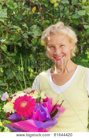 Portrait Of A Woman In The Garden With A Bouquet Of Flowers