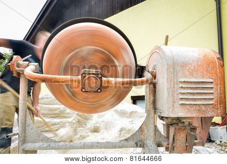 Man Working With Front Of Concrete Cement Mixer At Construction Site