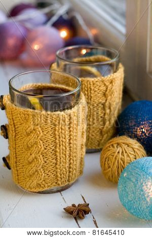 Two Cups Of Delicious Tea In Yellow Knitted Sweater