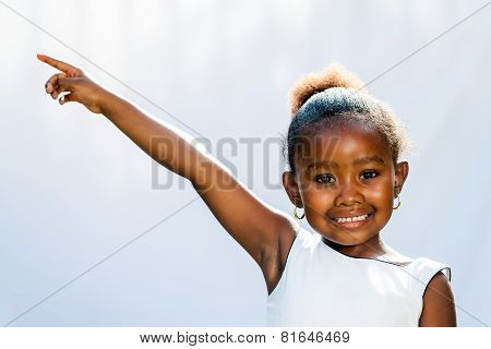 African Girl Pointing At Corner With Finger.
