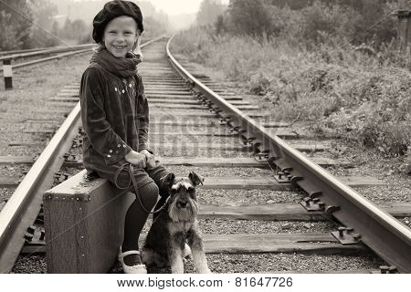 Little Girl Traveling With Her Dog. The Old European Photo.