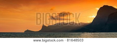Panorama sunset on a mountain ridge in the sea