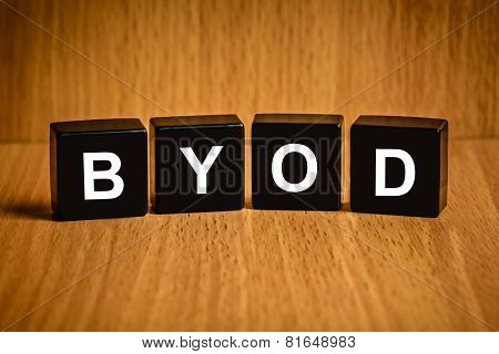 Byod Or Bring Your Own Device Word On Black Block