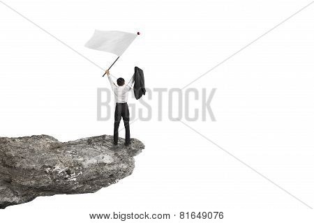 A Businessman Cheering On Cliff Waving Flag With White Background