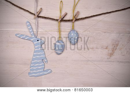 Blue Easter Bunny And Easter Eggs Hanging On Line