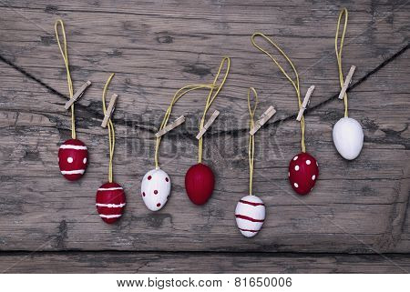 Many Red And White Easter Eggs Hanging On Line
