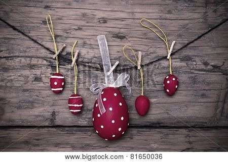 Many Red Easter Eggs And One Big Egg Hanging On Line Frame