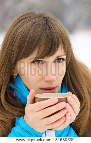 Young Caucasian Woman Drinking Hot Coffee Or Tea