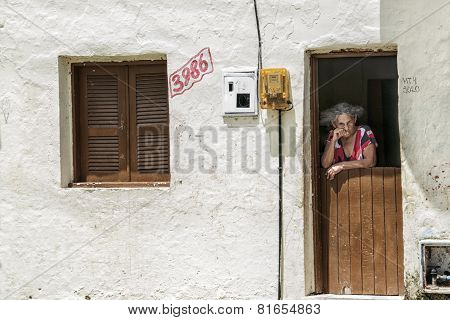 Elderly Woman On The Front Door