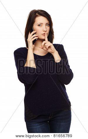 Businesswoman gesturing finger on lips