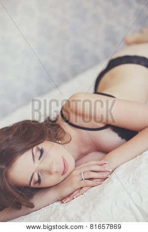 Young woman in bed in the morning.