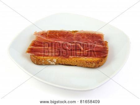 Serrano ham on toasted bread. Jabugo. Spanish tapa.