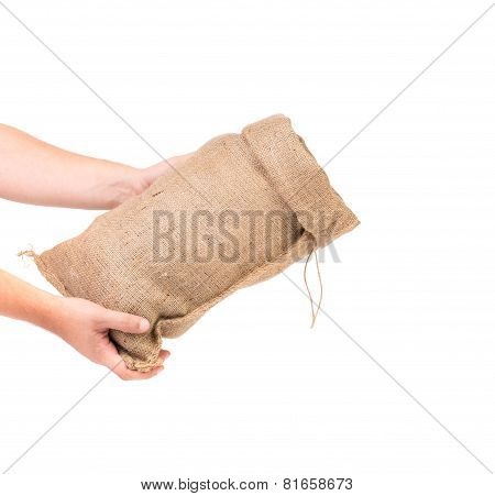 Hand holds bag