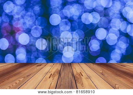 Wood Flooor And Abstract Circular Boken Nigth Background