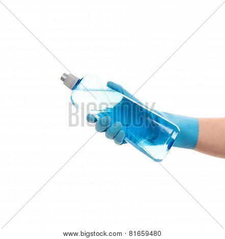 Hand holding blue plastic bottle.