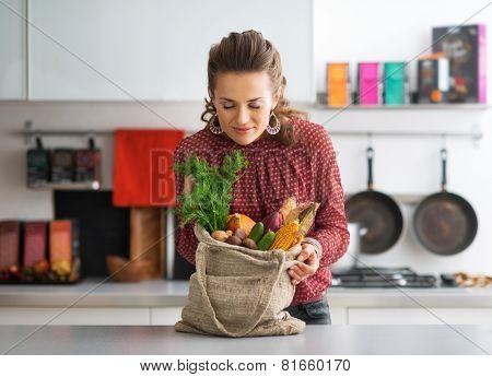 Young Housewife Enjoying Freshness Of Local Market Purchases
