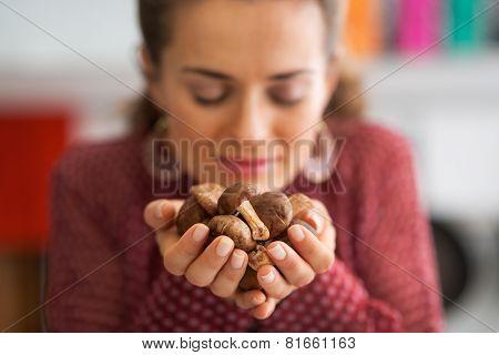 Closeup On Young Housewife Enjoying Freshness Of Shiitake Mushro