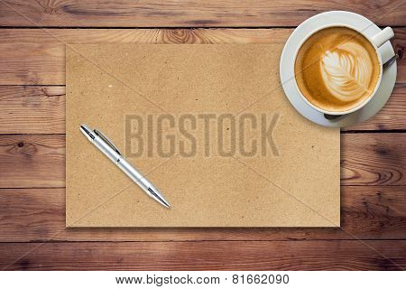 Brown Paper And Coffee On Wood Background With Pen