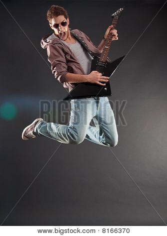 Passionate Guitarist Jumps