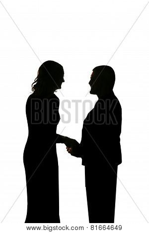 Silhouette Of Young Loving Couple Holding Hands