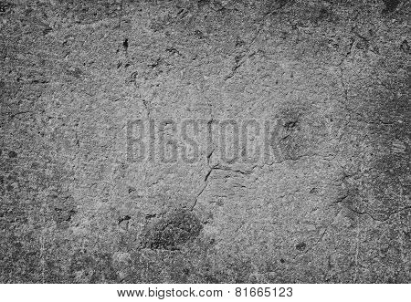 Texture of stone for background and design.Tufa stone wall background in monochrome
