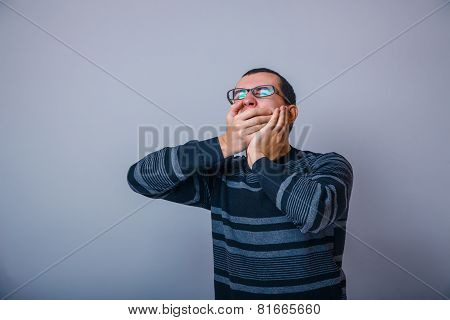 European-looking male of about thirty shut his mouth yawns hands