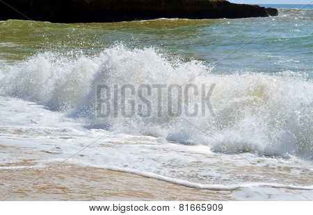 Senhora Da Rocha Beach, a rough sea in Portugal