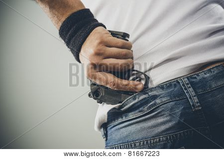 Man Grabbing His Pistol