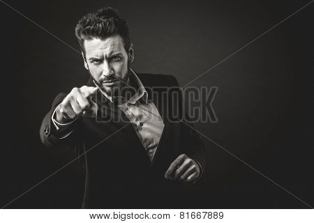 Aggressive Businessman Pointing Finger