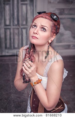 Beautiful Steampunk Woman In Corset Praying