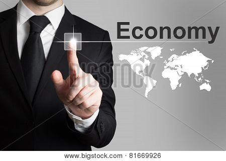 Businessman Pushing Button Economy Worldmap