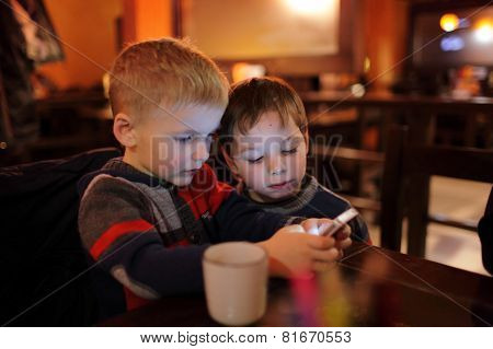 Two Brothers With Smartphones
