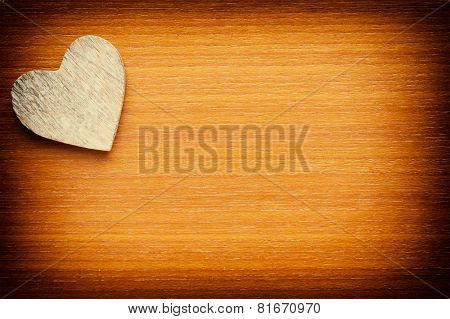Wooden heart on a grunge wooden background