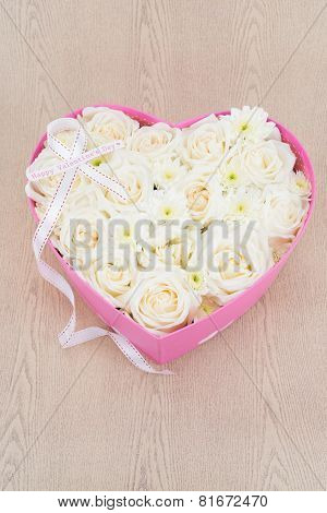 White Roses And Pearl And Diamond Held In The Heart Shape Box