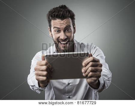 Cheerful Man Watching Videos On Tablet