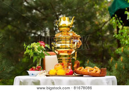 Spring Tea Party In The Garden, On A Table Covered With A White Tablecloth, Russian Samovar And Tea,