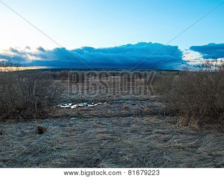 Image of the countryside and cloudy sky