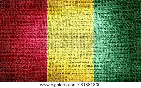 Guinea flag on burlap fabric