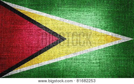 Guyana flag on burlap fabric