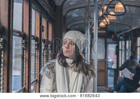 Beautiful Young Woman Posing On A Tram