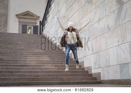 Beautiful Young Woman Jumping Down Stairs