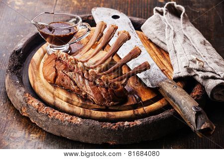 Raw Fresh Marinated Veal Ribs And Meat Cleaver On Wooden Background
